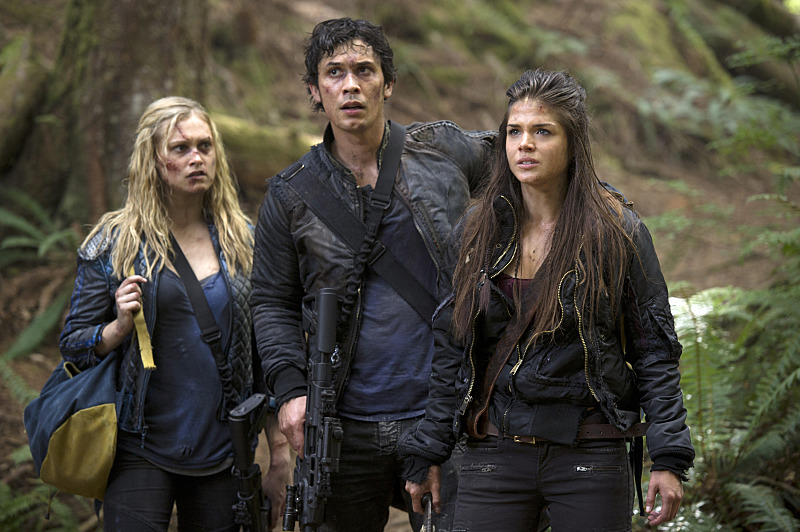 "The 100 -- ""Human Trials"" -- Image: HU205a_0026 -- Pictured (L-R): Eliza Taylor as Clarke, Bob Morley as Bellamy, and Marie Avgeropoulos as Octavia -- Photo: Carole Segal/The CW -- © 2014 The CW Network, LLC. All Rights Reserved"